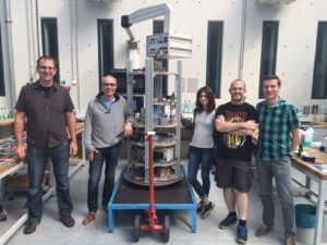 Jan Siemer (ZARM), Devaraj van der Meer (University of Twente), Patricia Vega Martínez (Universidad Carlos III de Madrid), Javier Rodríguez Rodríguez (Universidad Carlos III de Madrid), and Michael Heseding (ZARM) in front of the drop capsule (from left to right) in July 2016. Not in the picture: Torsten Lutz (ZARM) and Matthias Sperl (DLR-MP).